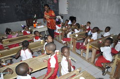 AFRICAN STUDENTS IN CLASS. Single image of children breast garden in the class with their teacher to acquire knowledge and skills Royalty Free Stock Images