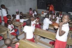 AFRICAN STUDENTS IN CLASS. Single image of children breast garden in the class with their teacher to acquire knowledge and skills Stock Photos