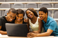 African students laptop. Group of african american college students friends using laptop in lecture room Royalty Free Stock Photo