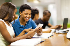African students tablet computer. Happy african college students using tablet computer together royalty free stock image