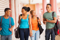 African students walking. Group of cheerful african college students walking in building corridor Stock Photos