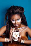 African style . Attractive young woman in ethnic jewelry . close up portrait of a woman with a painted face. Creative make up Royalty Free Stock Photography