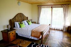 African style bedroom. Neatly prepared bedroom in african stle with wood and african motives Royalty Free Stock Images