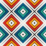 African style seamless pattern in bright colors. Ethnic and tribal motif. Repeated rhombuses abstract background. African style seamless surface pattern in Stock Images