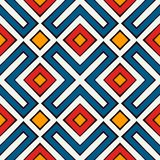 African style seamless pattern in bright colors. Ethnic and tribal motif. Repeated rhombuses abstract background. African style seamless surface pattern in Stock Image