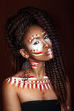 African style woman . Attractive young woman in ethnic jewelry. close up portrait. Portrait of a woman with a painted face. Stock Photo