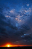 African sunset. Sunset in Serengeti National Park, vertically with a cloudy sky Stock Image