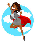 African super business woman. Dark skinned business woman with a superhero's cape flying in the sky Stock Photography
