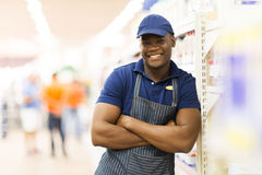 African supermarket worker. Portrait of african supermarket worker with arms folded Royalty Free Stock Photography