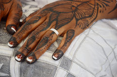 African tattoo. Tattoos done on the hands and feet of brides for an ethnic group in Ivory Coast. Ivory coast with 60 ethnic groups Royalty Free Stock Photos
