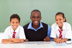 African teacher students. African elementary school teacher and students in classroom stock images