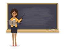 African teacher teaching in classroom. African teacher, black professor standing in front of blackboard teaching student in classroom at school, college or Stock Photo
