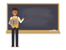 African teacher teaching in classroom Stock Photo