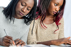 African teen students working together at desk. royalty free stock photos