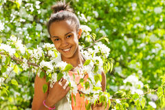African teenager girl with white pear flowers Royalty Free Stock Photography