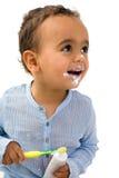 African toddler brushing teeth royalty free stock photography