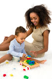 African toddler playing with blocks stock photo