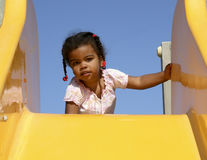 African toddler on slide Royalty Free Stock Photography