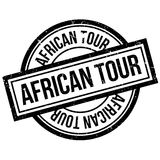 African Tour rubber stamp. Grunge design with dust scratches. Effects can be easily removed for a clean, crisp look. Color is easily changed Stock Photo