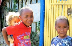 African Township Children. Closeup of two happy smiling curious children in the township of Masiphumelele, Cape Town, South Africa stock image