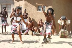 African traditional dancers. Africans dancing in a local village for tourism Royalty Free Stock Photos