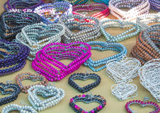 African traditional ethnic handmade colorful beads wire accessories hearts. Royalty Free Stock Image