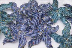 African traditional handmade blue bead toys starfishes. South Africa. Royalty Free Stock Photography