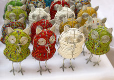 African traditional handmade colorful bead wire toys animal bird owl. African traditional ethnic handmade colorful bead wire toys animal bird owl on white royalty free stock photos