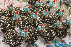 African traditional handmade colorful bead wire toys animal birds. Stock Image