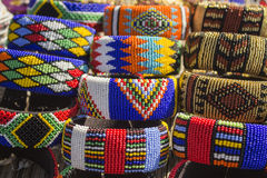African traditional handmade colorful beads bracelets, bangles. Local craft market in South Africa. Unique handmade colorful beads bracelets, bangles royalty free stock photos