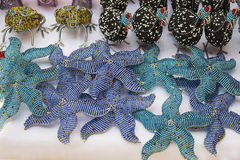 African traditional handmade colorful beads toys animals, starfish. Stock Photo