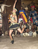 African tribal dance in traditional handmade costumes. South Africa, Gauteng, Lesedi Cultural Village (unique center of African culture) - 04 July, 2015. Tribal Royalty Free Stock Photo