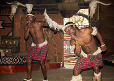 African tribal dance in traditional handmade costumes. South Africa, Gauteng, Lesedi Cultural Village (unique center of African culture) - 04 July, 2015. Tribal Stock Images