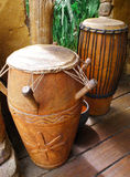 African tribal drums. A photograph image of two different types of native africa drums made from wood and animal hide.  Beautifully decorated with carvings on Royalty Free Stock Image