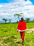 African tribal man. AFRICA, KENYA - NOVEMBER 8: portrait of an African tribal man, walking in tribal village near Masai Mara National Park Reserve on November 8 Royalty Free Stock Photo