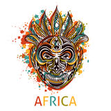 African tribal mask with ethnic geometric ornament and splashes in watercolor style. Royalty Free Stock Photos