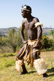 African tribe man. South African zulu tribe man dressed in traditional clothes dancing on wild mountain Stock Photography