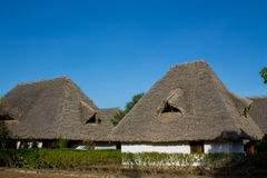 Africa tropical resort. African tropical resort traditional houses. Small bungalow house on beauteful luxury sea beach resort Stock Photography