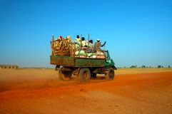 African truck with produce and people Royalty Free Stock Image