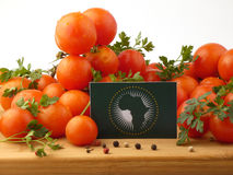 African Union flag on a wooden panel with tomatoes isolated on a Stock Photos
