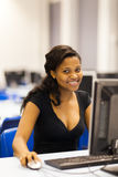 African university computer room. Pretty female African university student in computer room Royalty Free Stock Photo