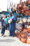 African migrant sells leather handbags at the market of Sineu, Mallorca, Spain Stock Images