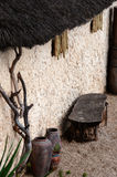 African village outdoor scene empty bench and pots straw roof Stock Photography