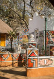African village. Traditional ethnic tribal painting style. Stock Photo