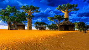 African village with traditional huts Stock Image