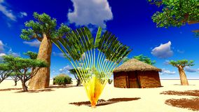 African village with traditional huts Stock Photos