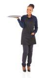 African waitress full length Stock Image