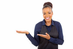 African waitress presenting Royalty Free Stock Photo