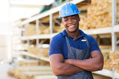 African warehouse worker. Handsome african male warehouse worker with arms crossed Stock Photography