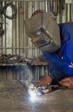 African welder with mask Royalty Free Stock Image